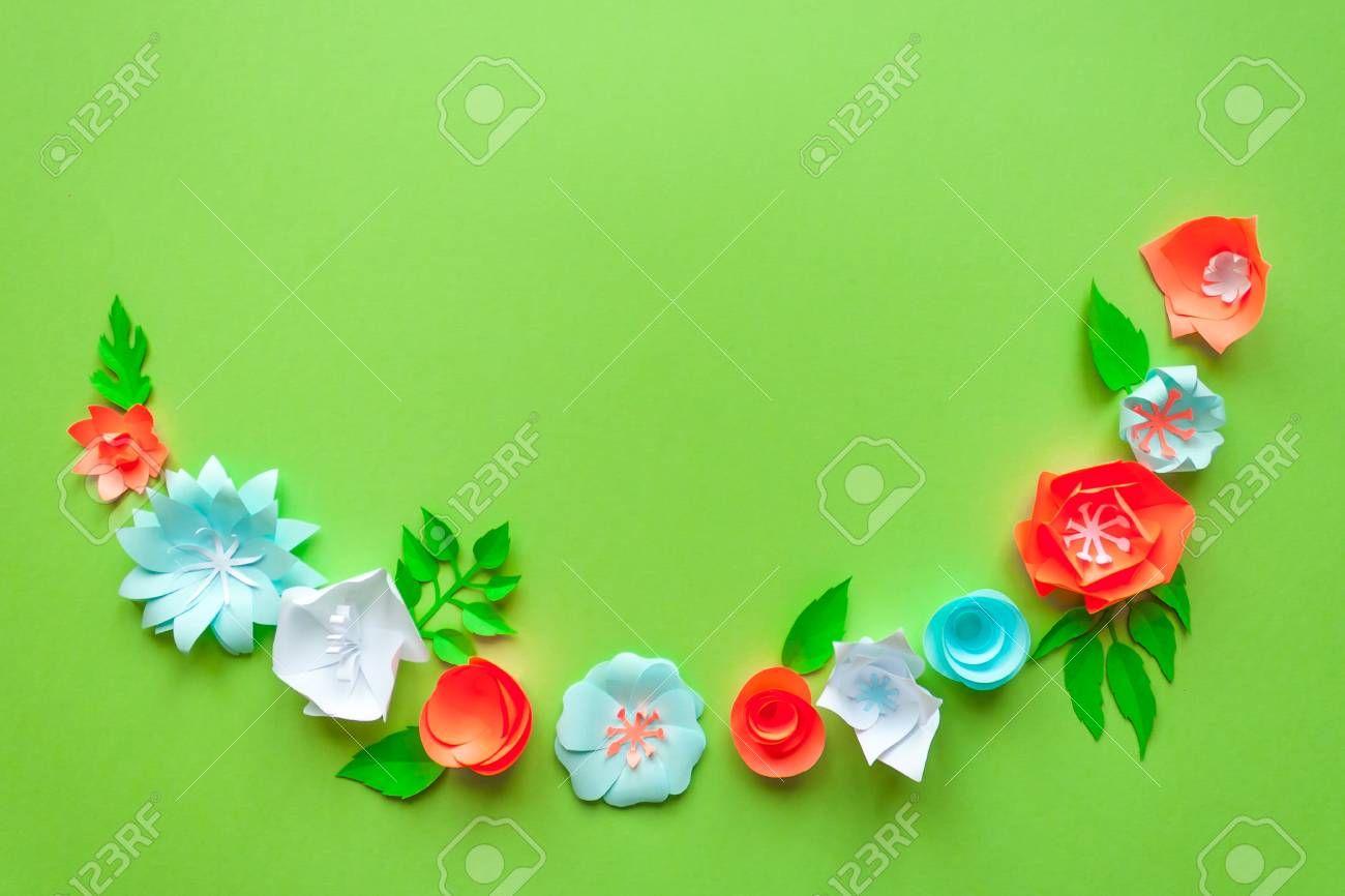 Frame with color paper flowers on the green background flat stock frame with color paper flowers on the green background flat lay nature concept mightylinksfo