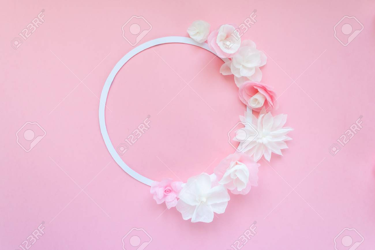 Round frame with white and rose paper flowers on pink background round frame with white and rose paper flowers on pink background cut from paper mightylinksfo