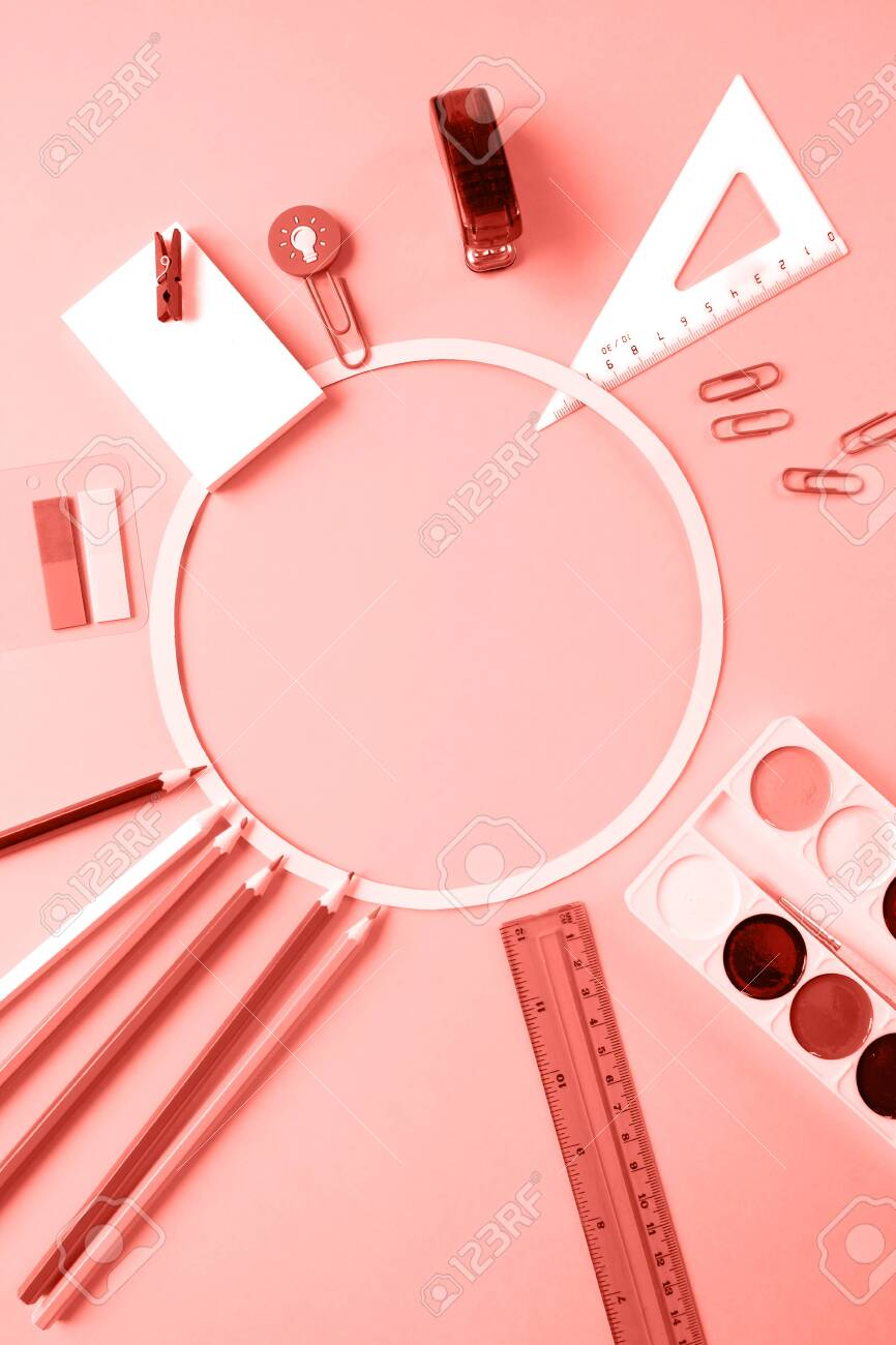 Round frame with colorful pencils scissors on chalkboard background, space for text, flat lay, back to school concept. Toned trendy coral - 127794546