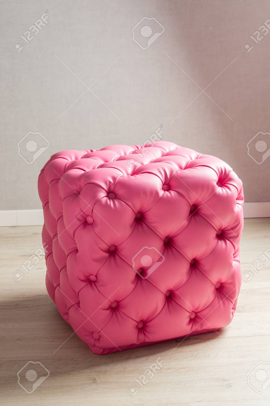 Pink pouf, furniture with decoration buttons in the home interior. - 101720387
