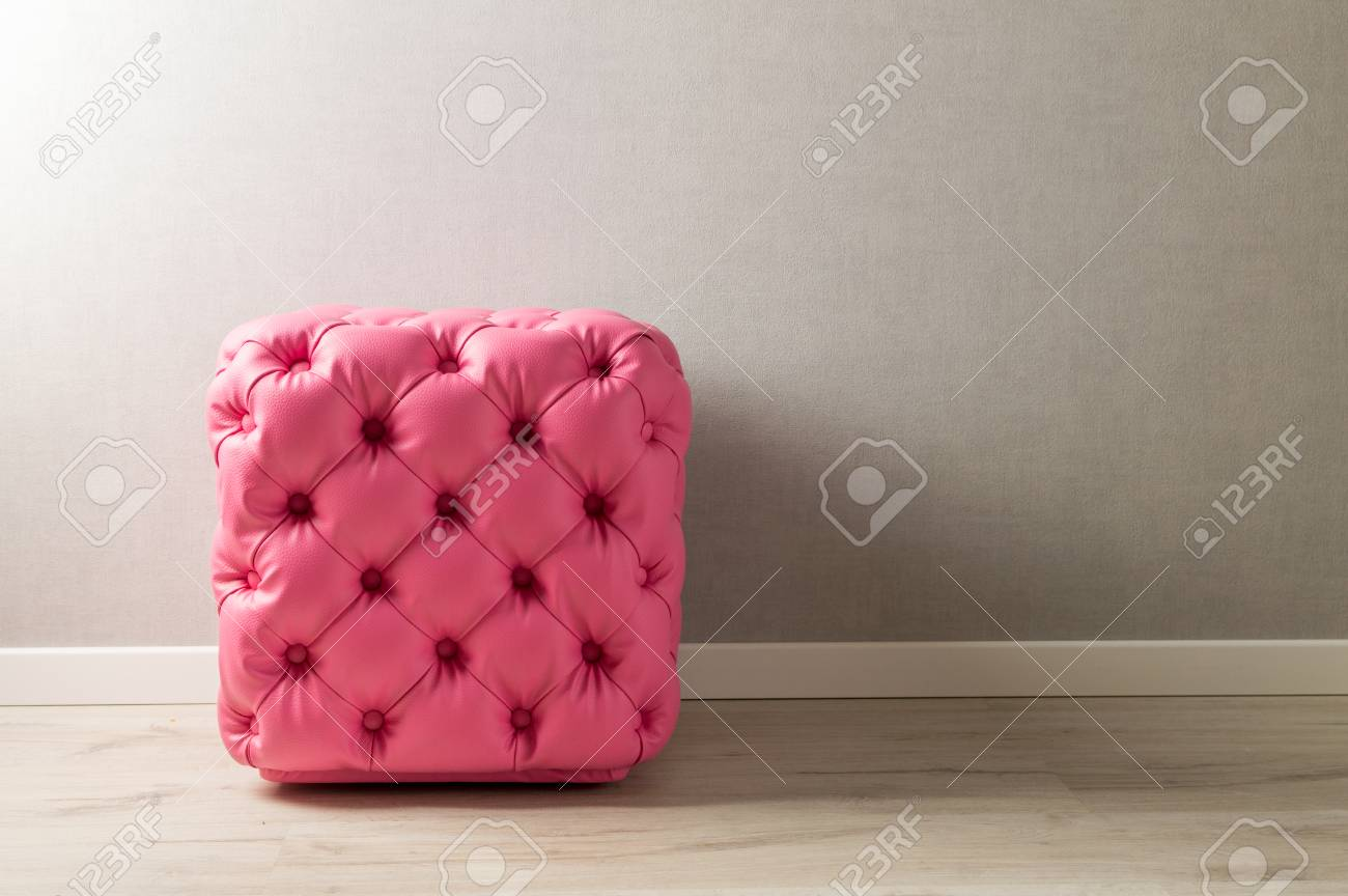 Pink pouf, furniture with decoration buttons in the home interior. - 106023673