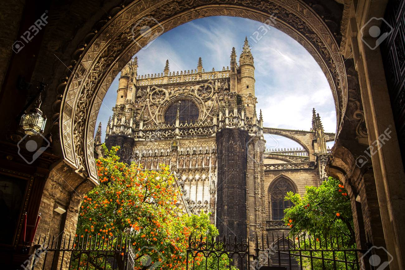 Sevilla Spain Church In Sevilla And Seville Cathedral Giralda Tower Orange Trees Stock Photo Picture And Royalty Free Image Image 101379605
