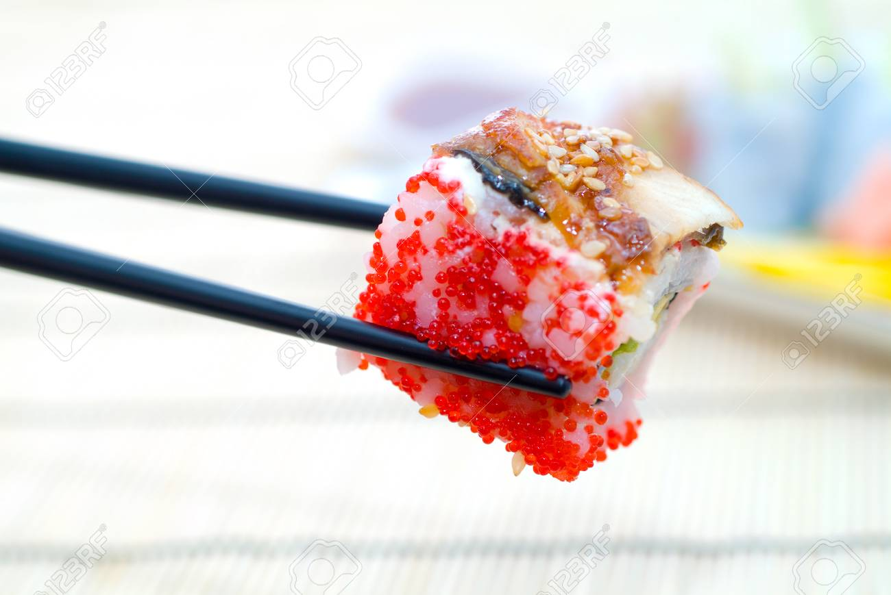 Sushi with chopsticks, With a back background Stock Photo - 1658005