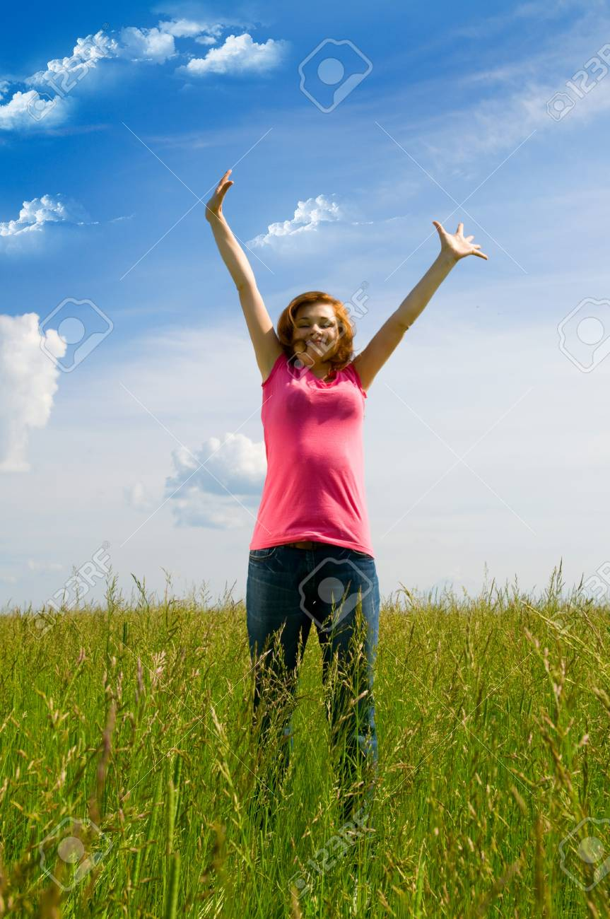 beautiful spreading her arms in the middle of a field Stock Photo - 4104292