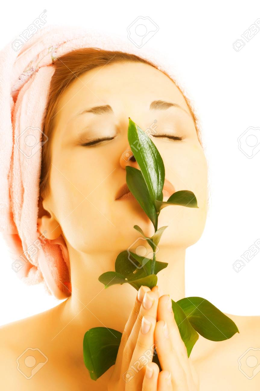 Beautiful young woman holding plant growing Stock Photo - 4791820