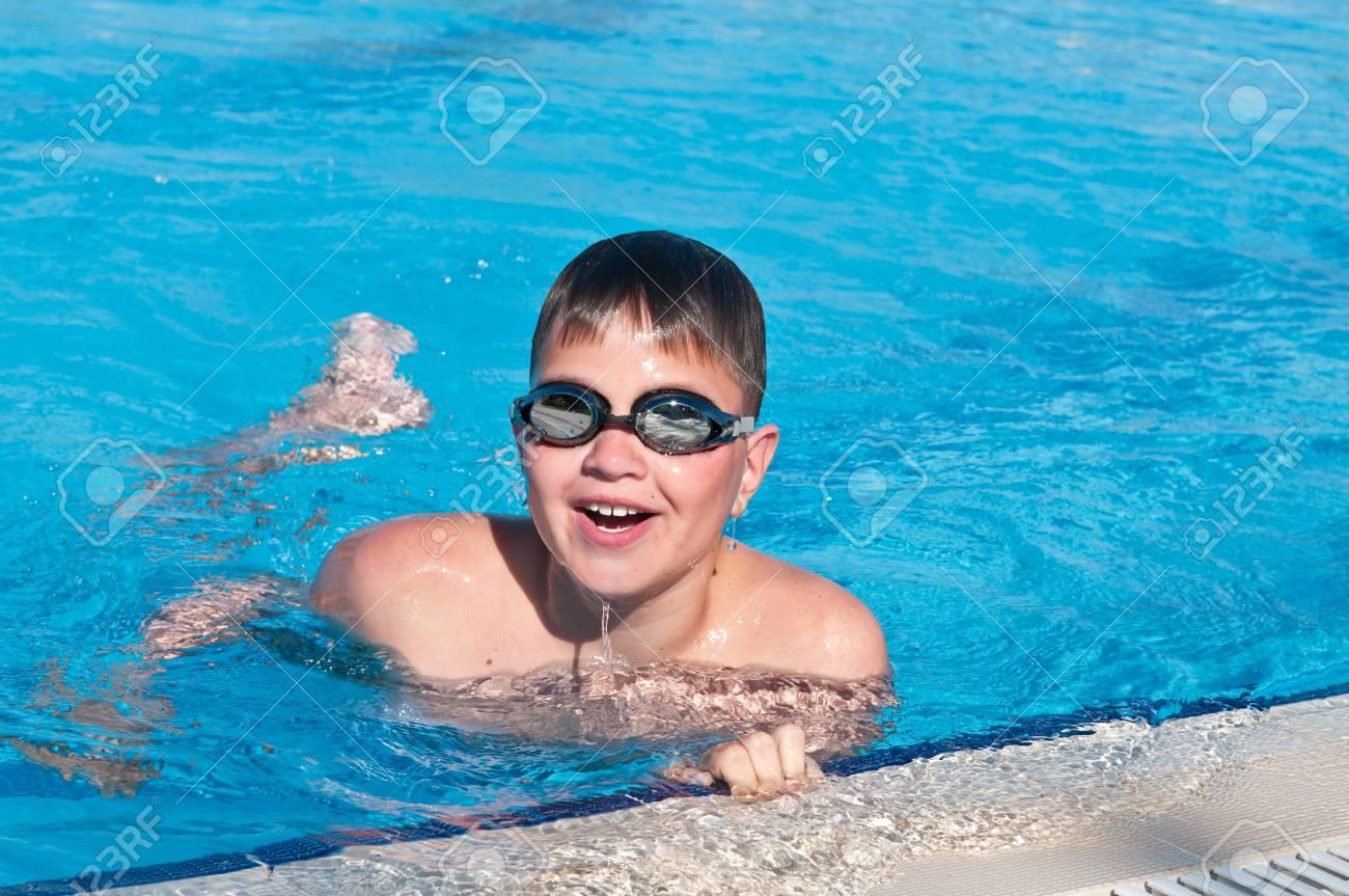 teenager swims in pool Stock Photo - 8047453