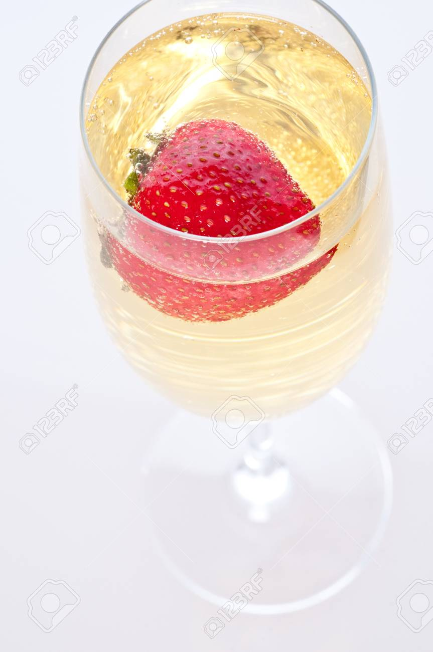 fresh strawberry floating in glass of champagne Stock Photo - 13880802