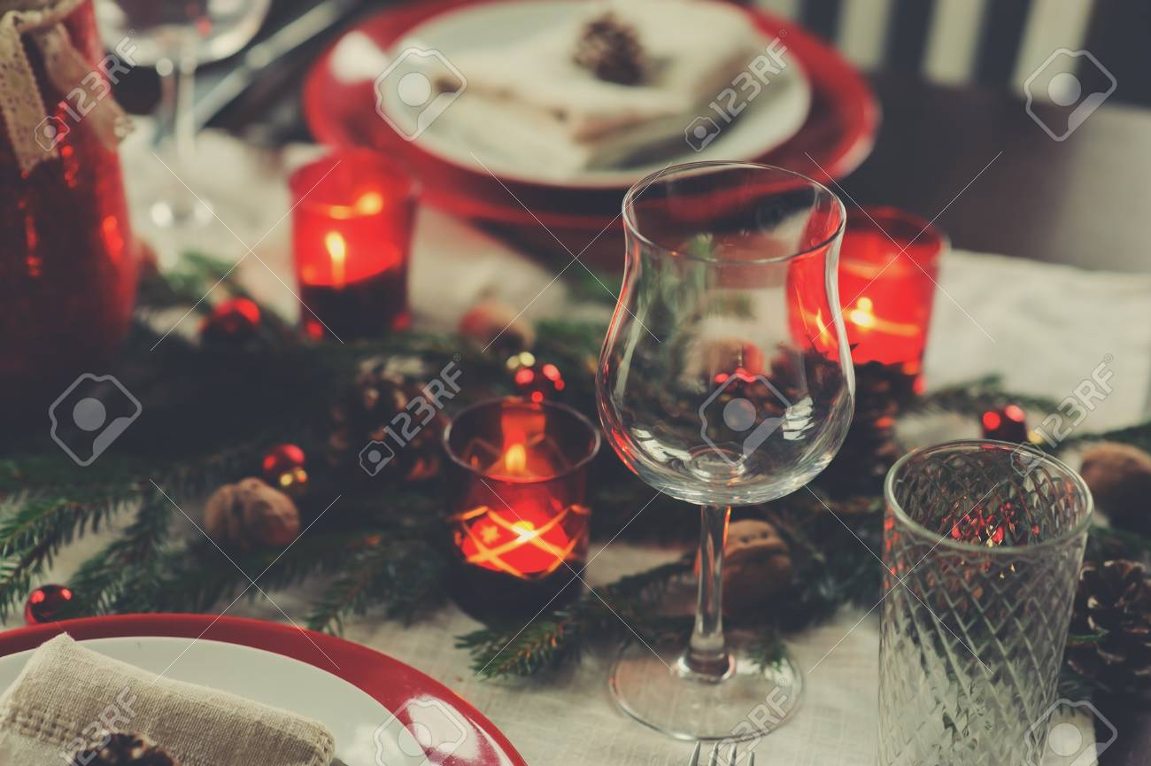 Table setting for celebration Christmas and New Year Holidays. Festive traditional red and green table at home with rustic details - 108364263