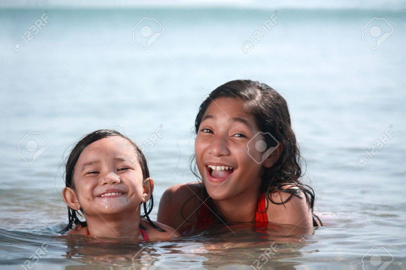 young asian kids enjoying a swim in the beach Stock Photo - 5930468