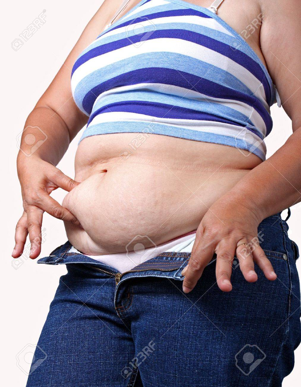 fat asian woman checking her belly fat Stock Photo - 6580420