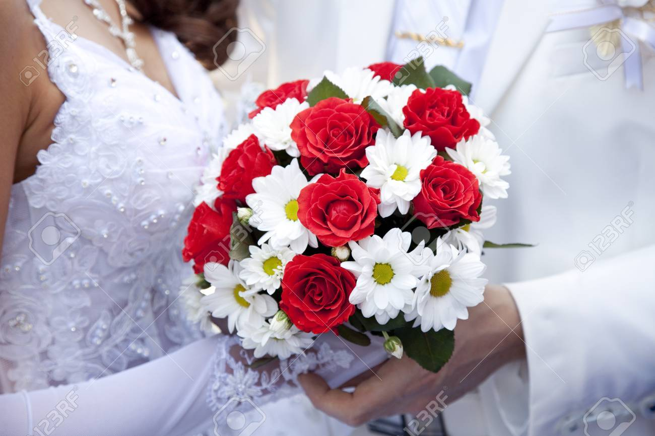 Bridegroom And Bride Holding Beautiful Red Roses Wedding Flowers