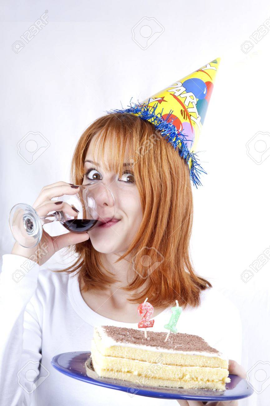 Red-haired with wine glass and cake celebrate her 21th birthday. Stock Photo - 7941314