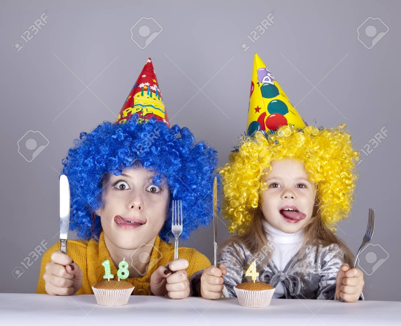 Two funny sisters four and eighteen years old in studio. Stock Photo - 8083621