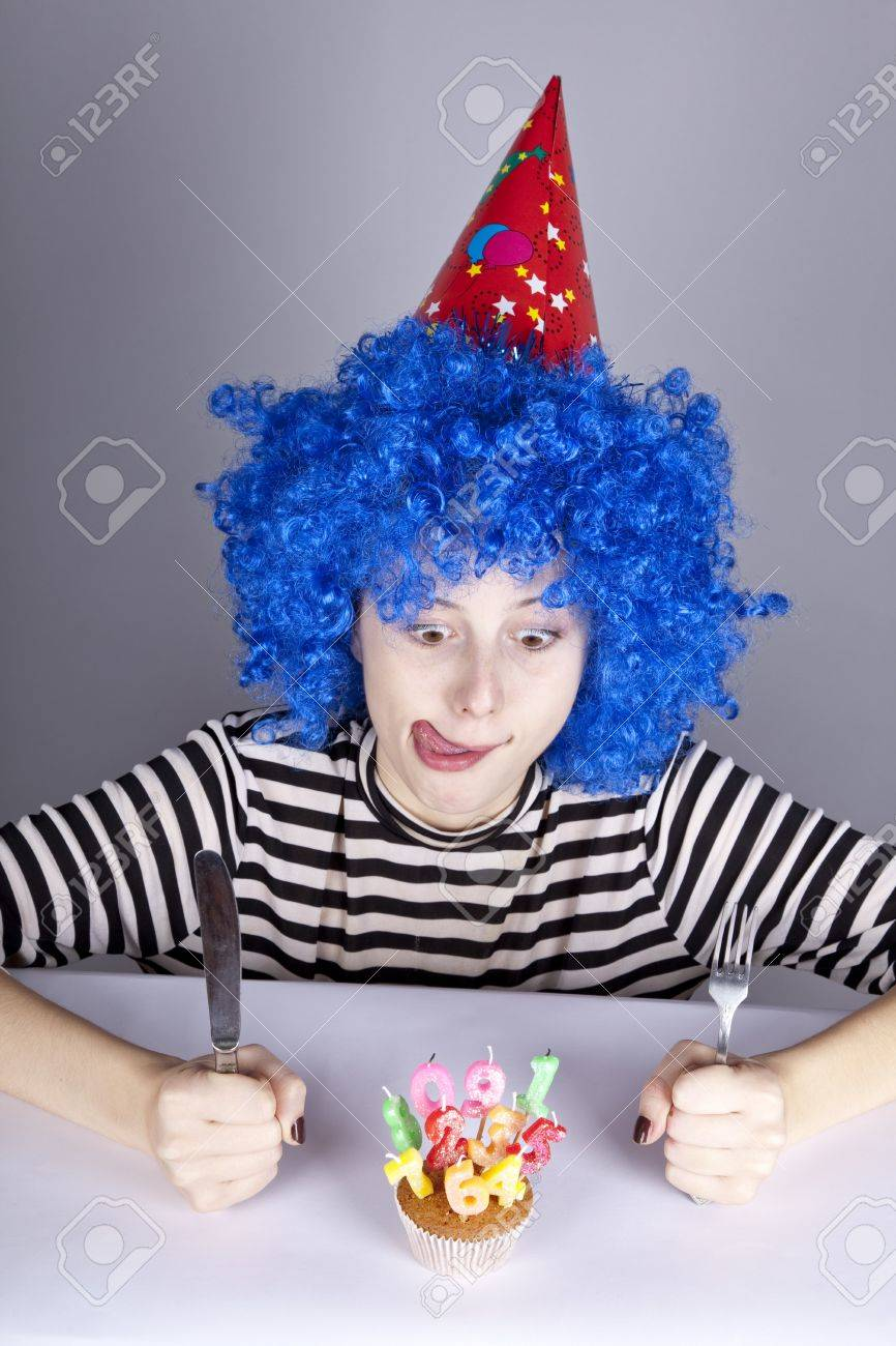 Funny blue-hair girl with cake. Studio shot. Stock Photo - 8083709
