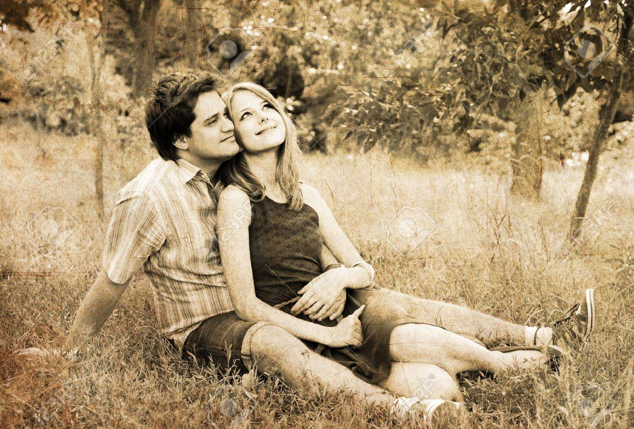 Young couple in love outdoors. Photo in old image style. Stock Photo - 10690051