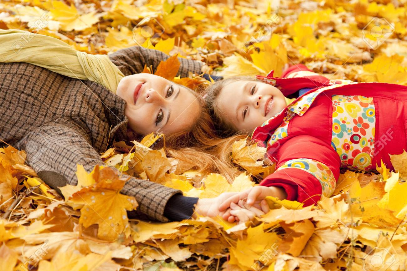 Mother and daughter in autumn yellow park. Stock Photo - 16619158
