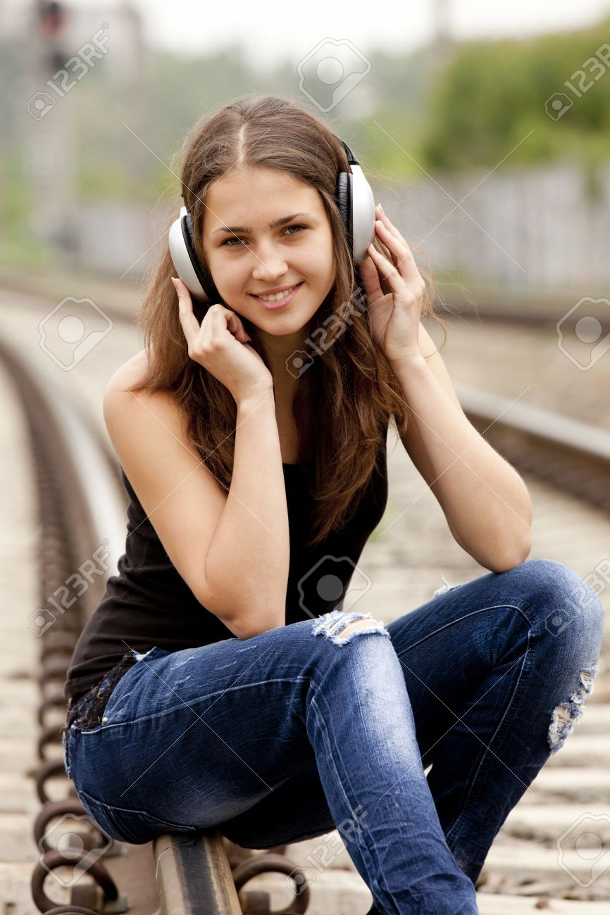 Teen girl with headphones at railways. Stock Photo - 13665966