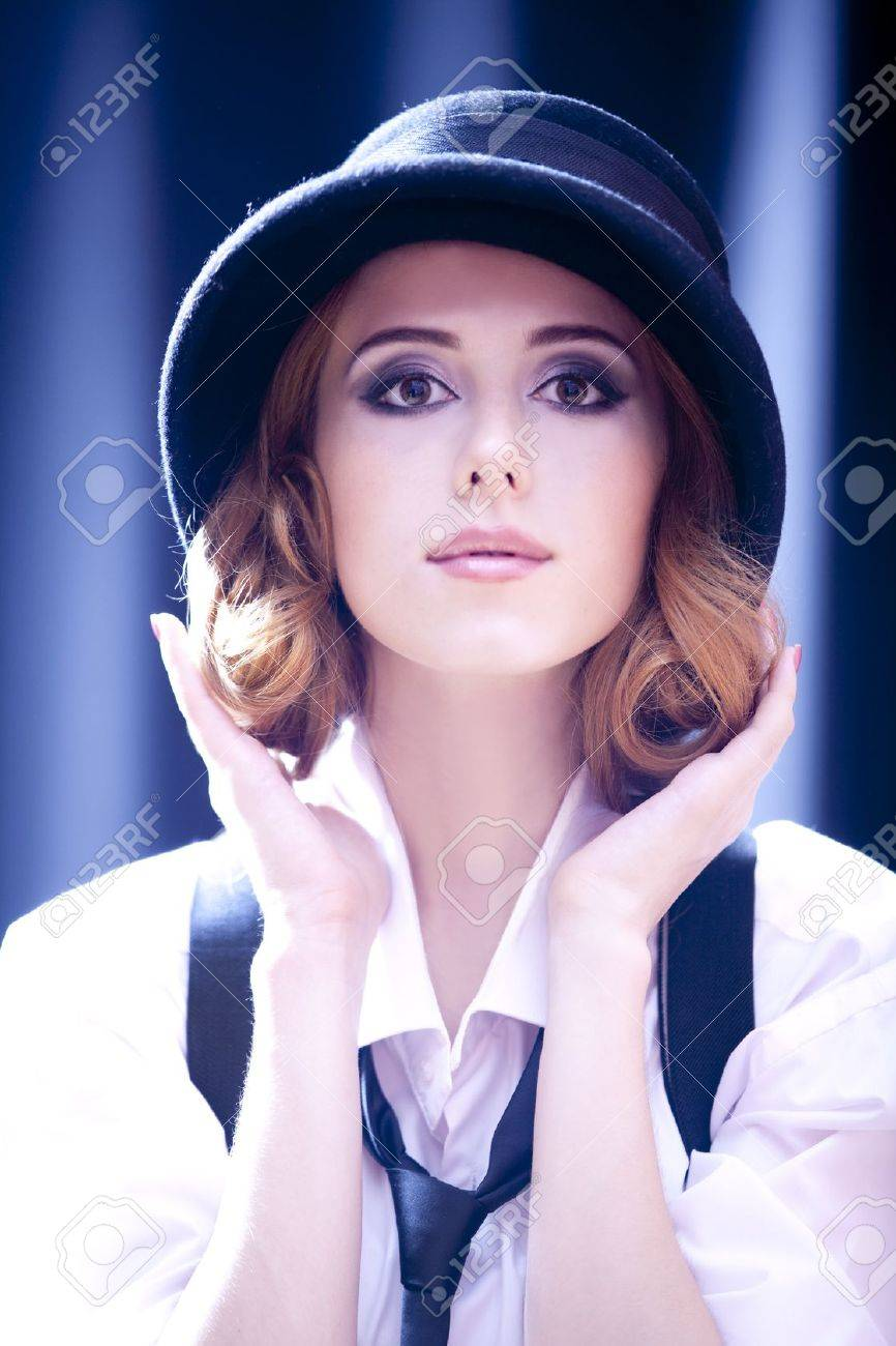 Fashion redhead girl with tie in studio. Stock Photo - 14728031