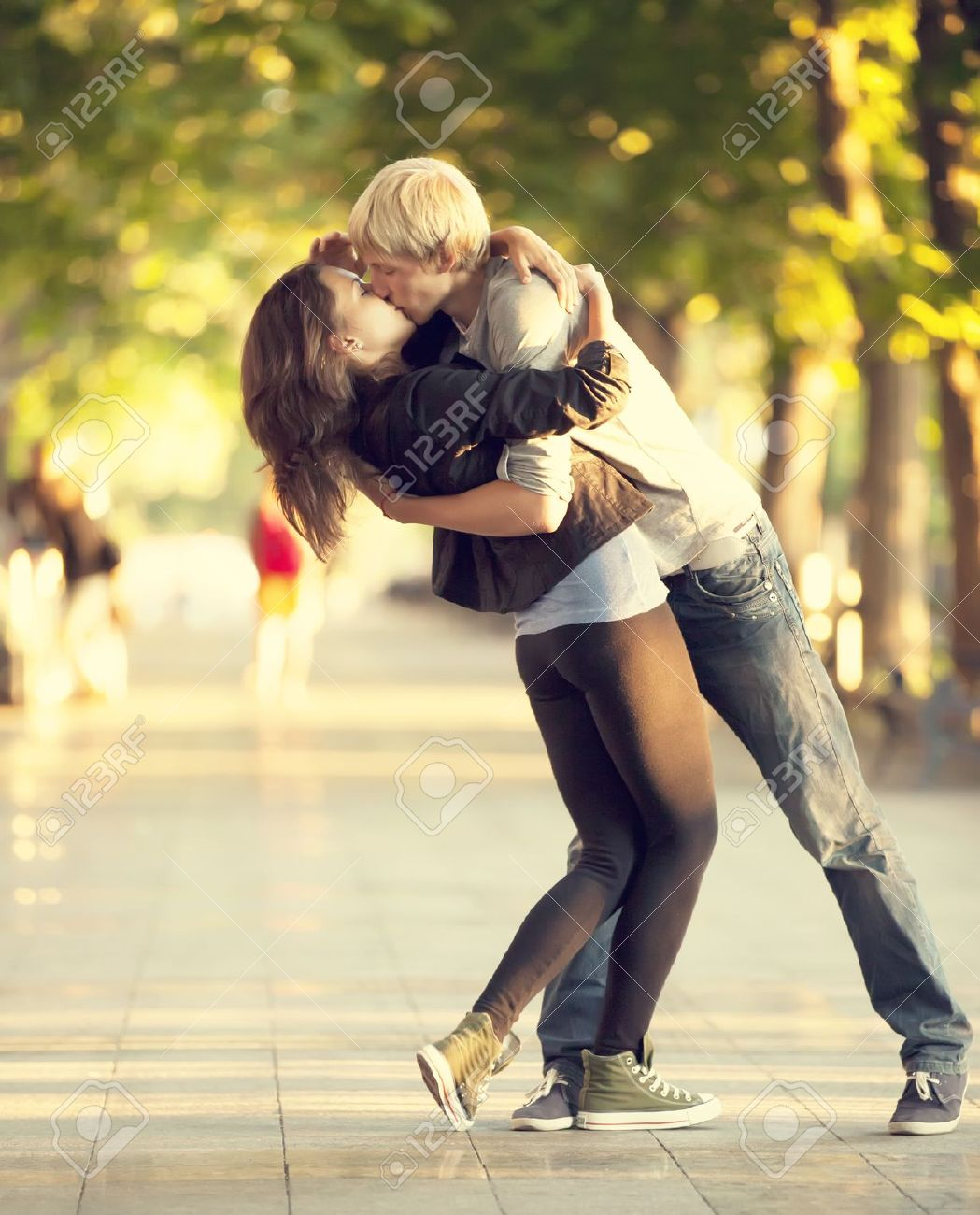 Young couple kissing on the street Stock Photo - 14727960