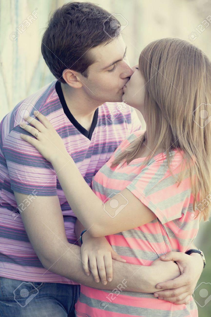 Young couple kissing near graffiti background. Stock Photo - 14728406