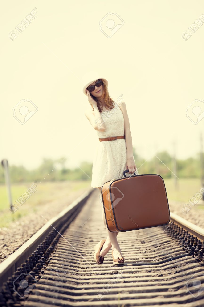 Young fashion girl with suitcase at railways. Stock Photo - 14725975