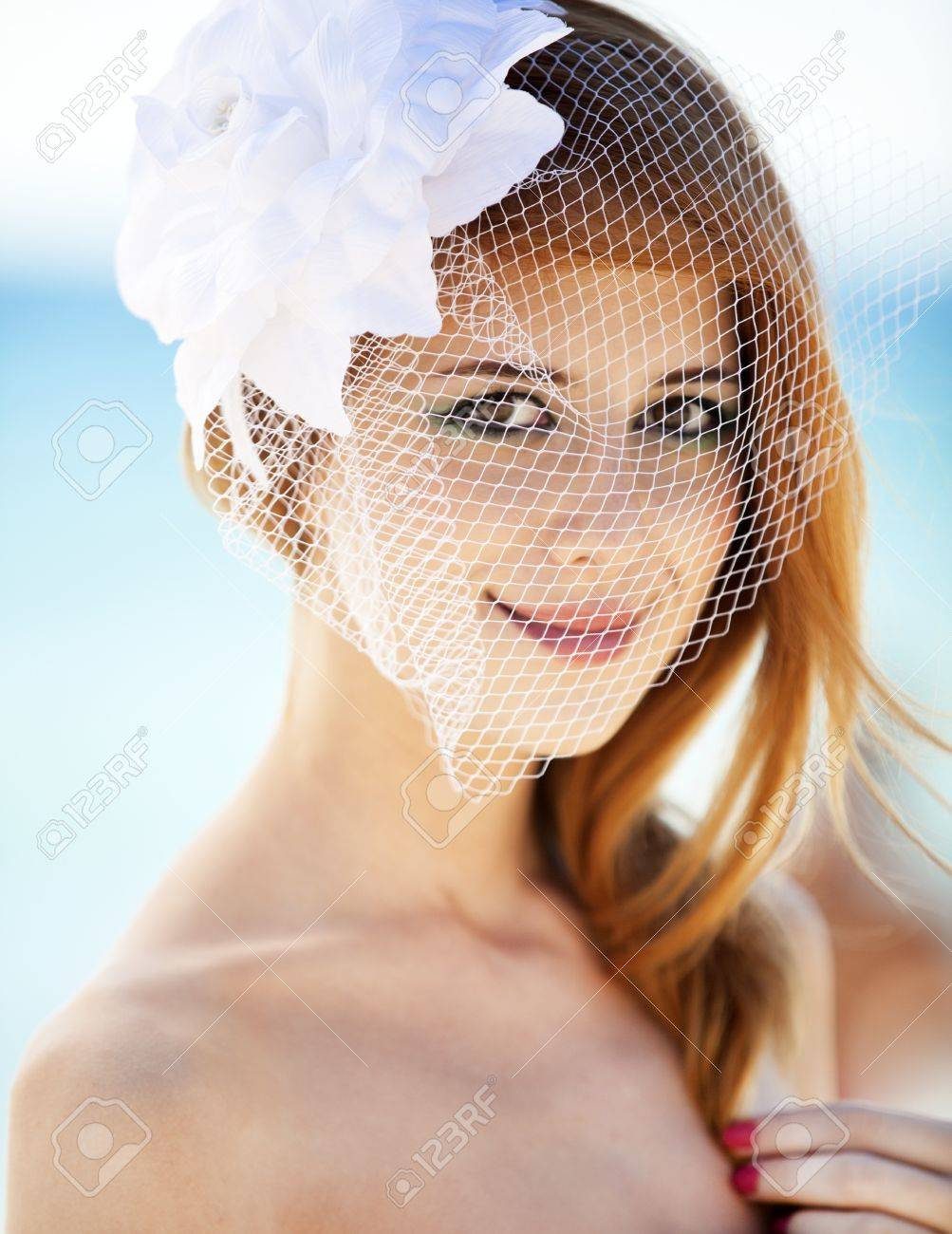 Young bride at the beach Stock Photo - 15071717