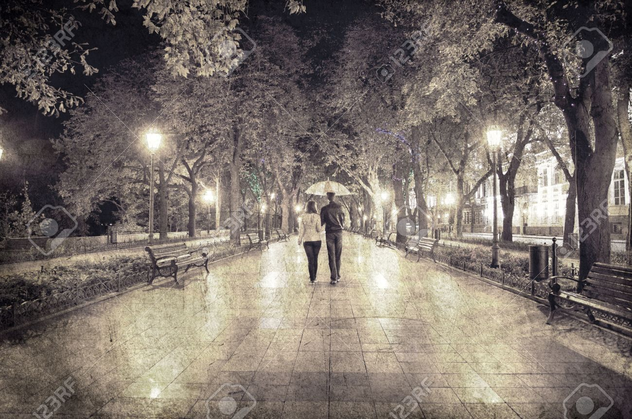 Couple walking at alley in night lights. Photo in vintage multicolor style. Stock Photo - 16009390