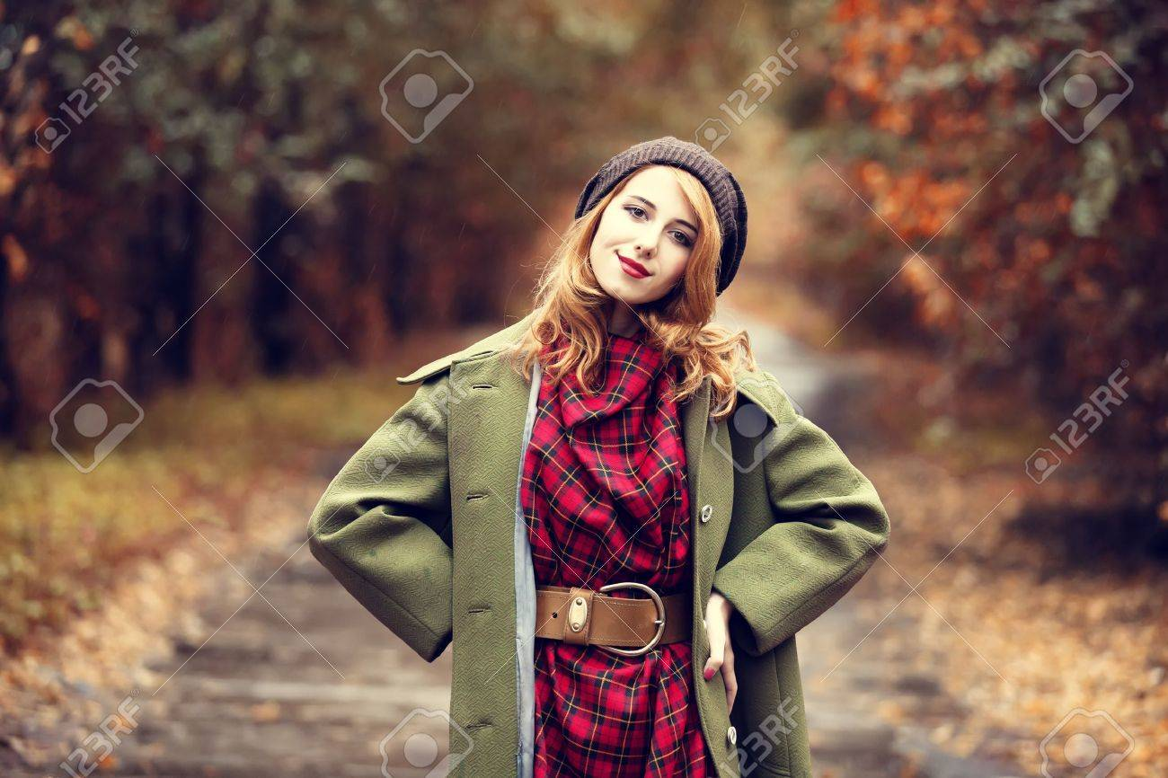 Style redhead girl at beautiful autumn alley. Stock Photo - 16141450