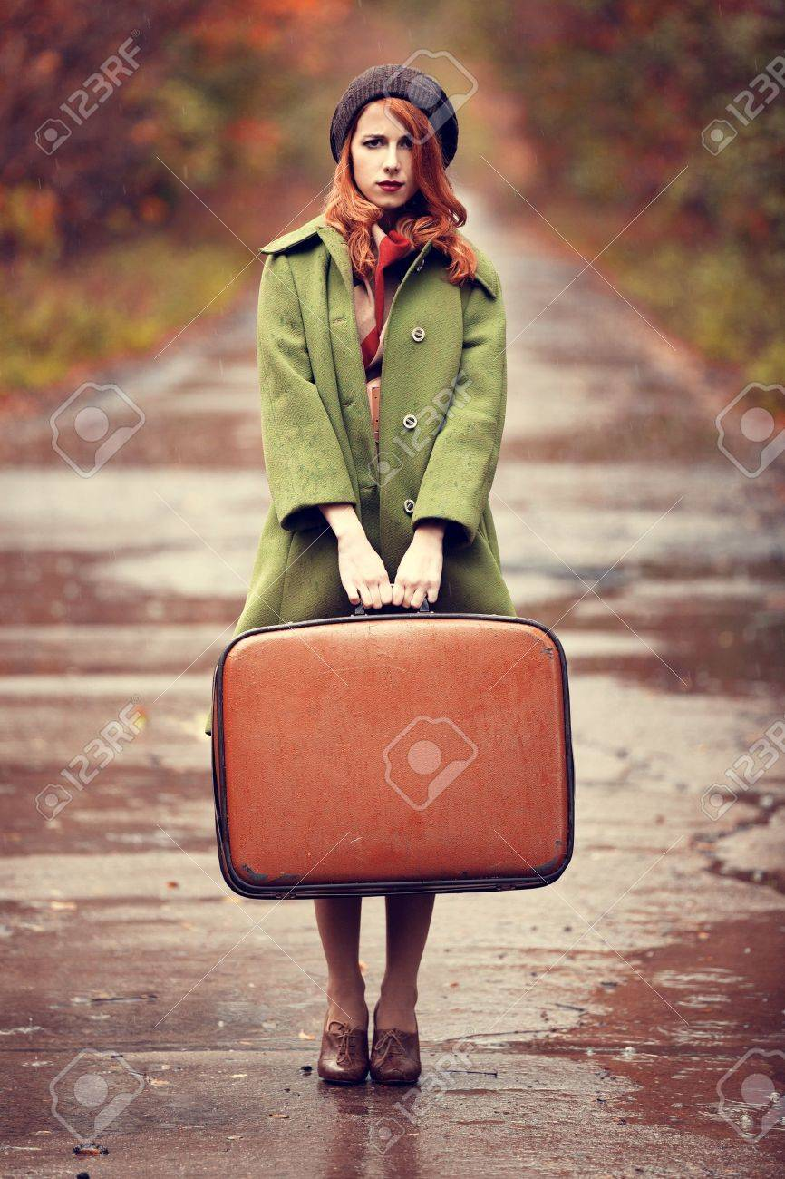 Style redhead girl with suitcase at beautiful autumn alley. Stock Photo - 16141453