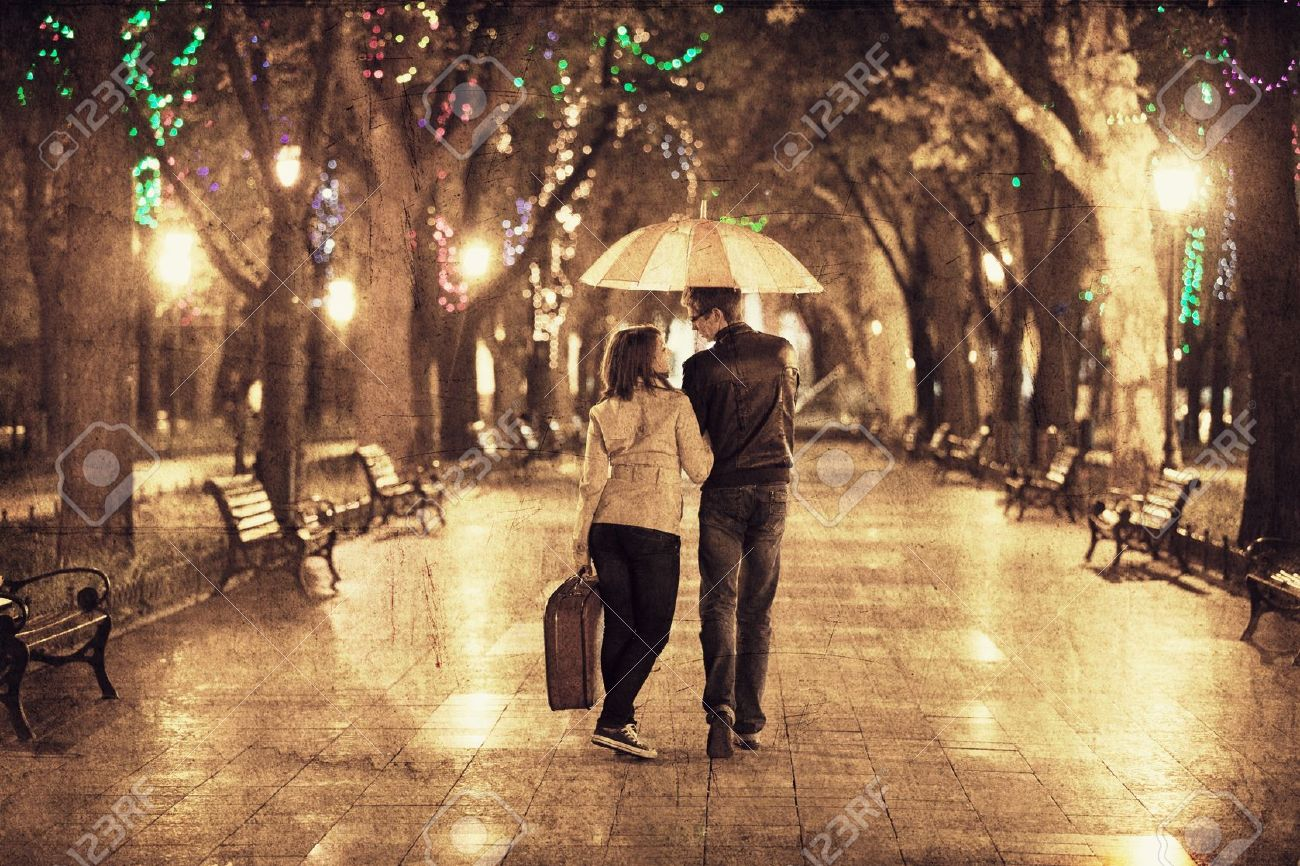 Couple walking at alley in night lights. Photo in vintage multicolor style. Stock Photo - 16304848