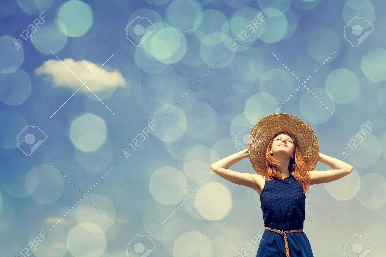 Redhead girl at spring blue sky background. Stock Photo - 16733810