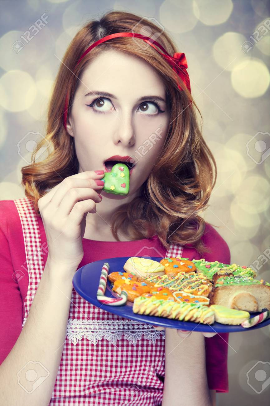 Redhead women with cookies Stock Photo - 17041147