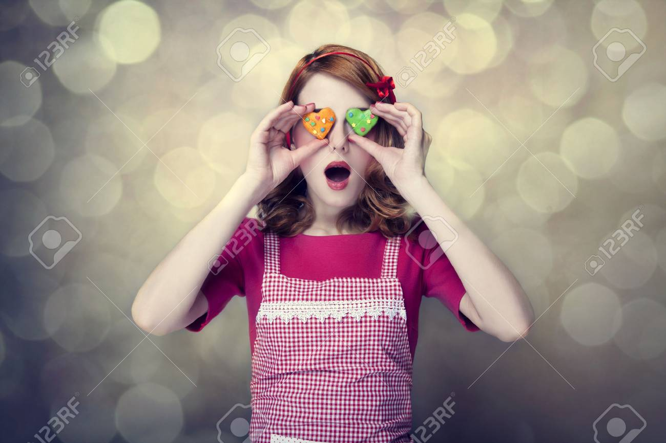 Redhead women with cookies Stock Photo - 17018085