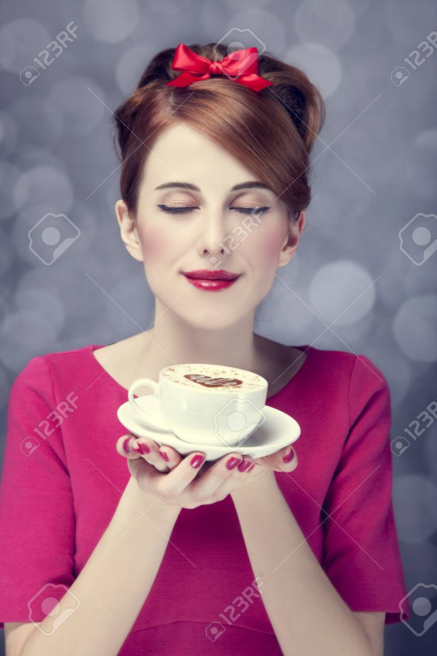 Redhead girl with coffee cup. St. Valentine Day. Stock Photo - 17147458