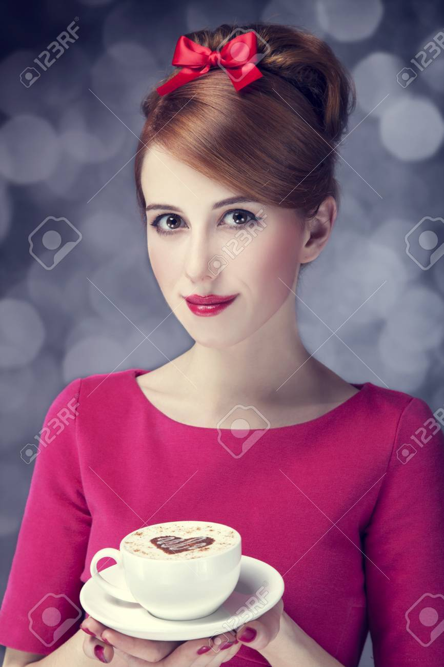 Redhead girl with coffee cup. St. Valentine's Day. Stock Photo - 17333272