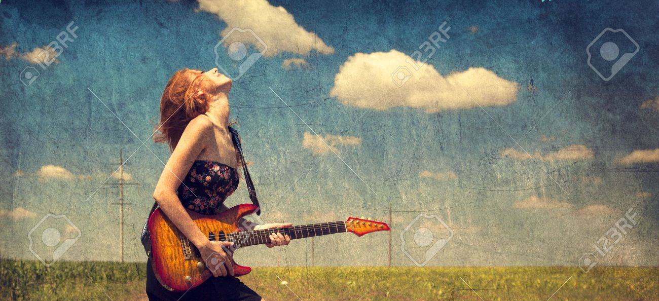 Red-head girl with guitar. Photo in old image style. Stock Photo - 17347538