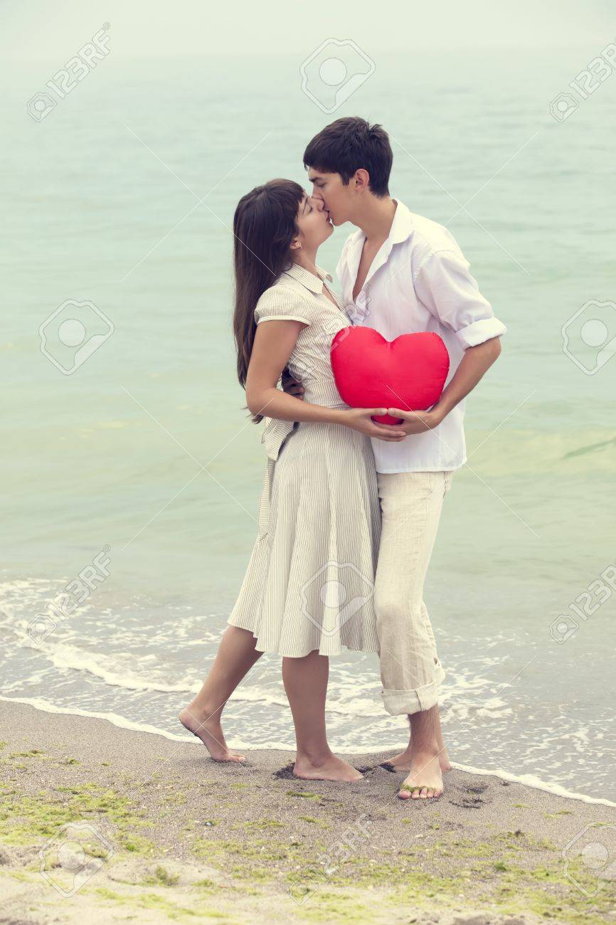 Closeup portrait of happy couple at the beach with heart. Stock Photo - 17542680