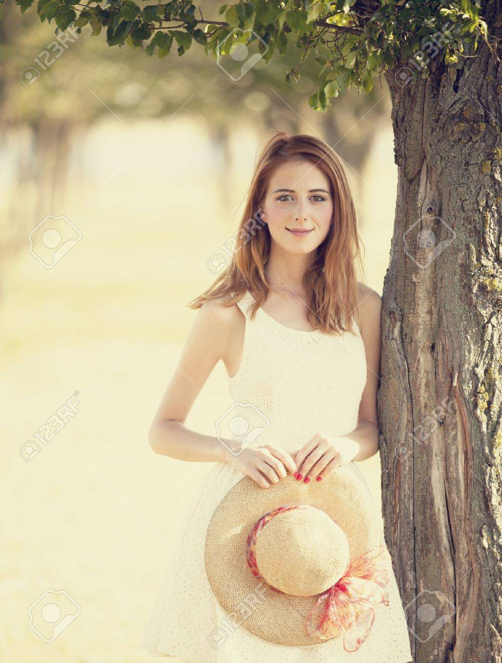 Redhead girl at tree's alley. Stock Photo - 17602523