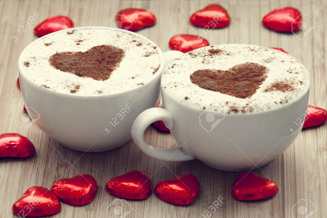 Two cup of coffee with heart symbol and candy around. Stock Photo - 17620447