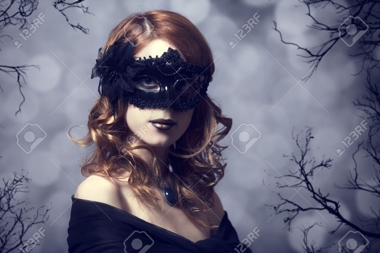 Beautiful women in carnival mask. Photo with forest at background. Stock Photo - 18059846