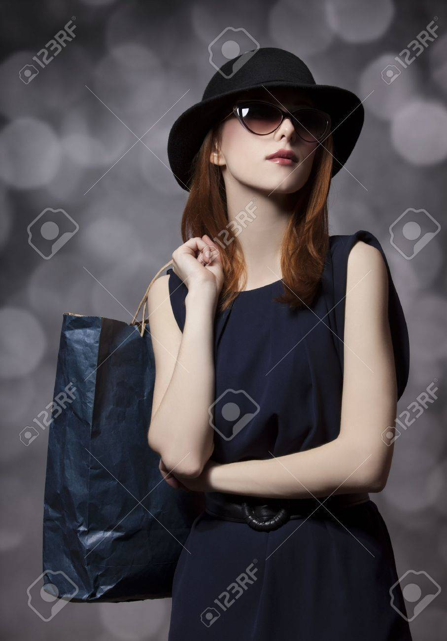 Style redhead girl with shopping bag Stock Photo - 18462304