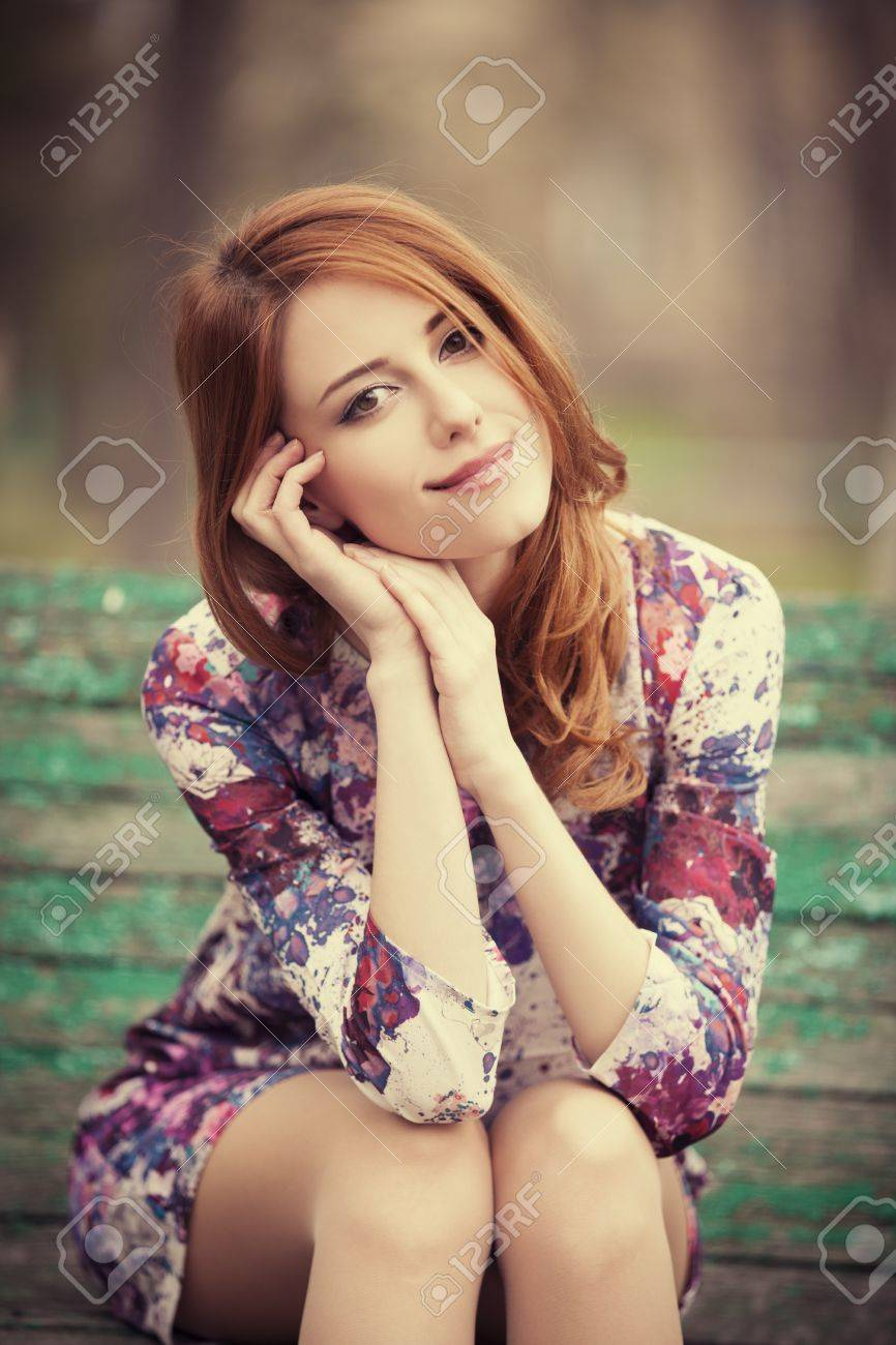 Style redhead girl sitting on the bench Stock Photo - 18878553