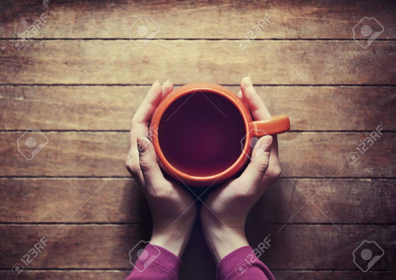 woman holding hot cup of tea Stock Photo - 19117995