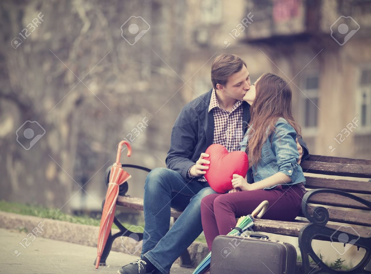 Young Couple Kissing On The Street Stock Photo Picture And Royalty