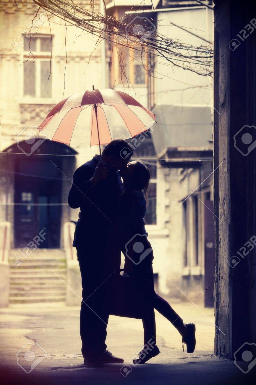Couple kissing at patio Stock Photo - 19337017