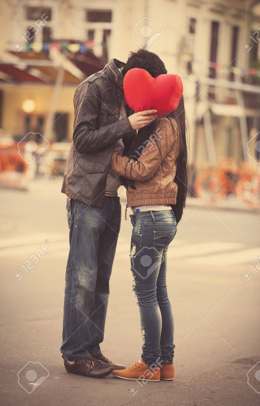Young couple with shape heart kissing on the street Stock Photo - 19336957