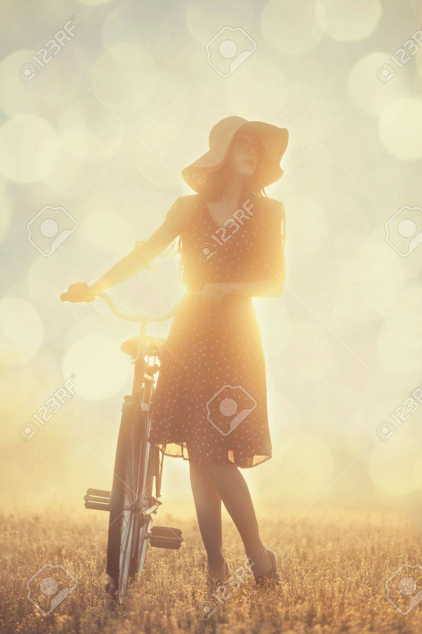 Girl and on a bike in the countryside in sunrise time Stock Photo - 19502153
