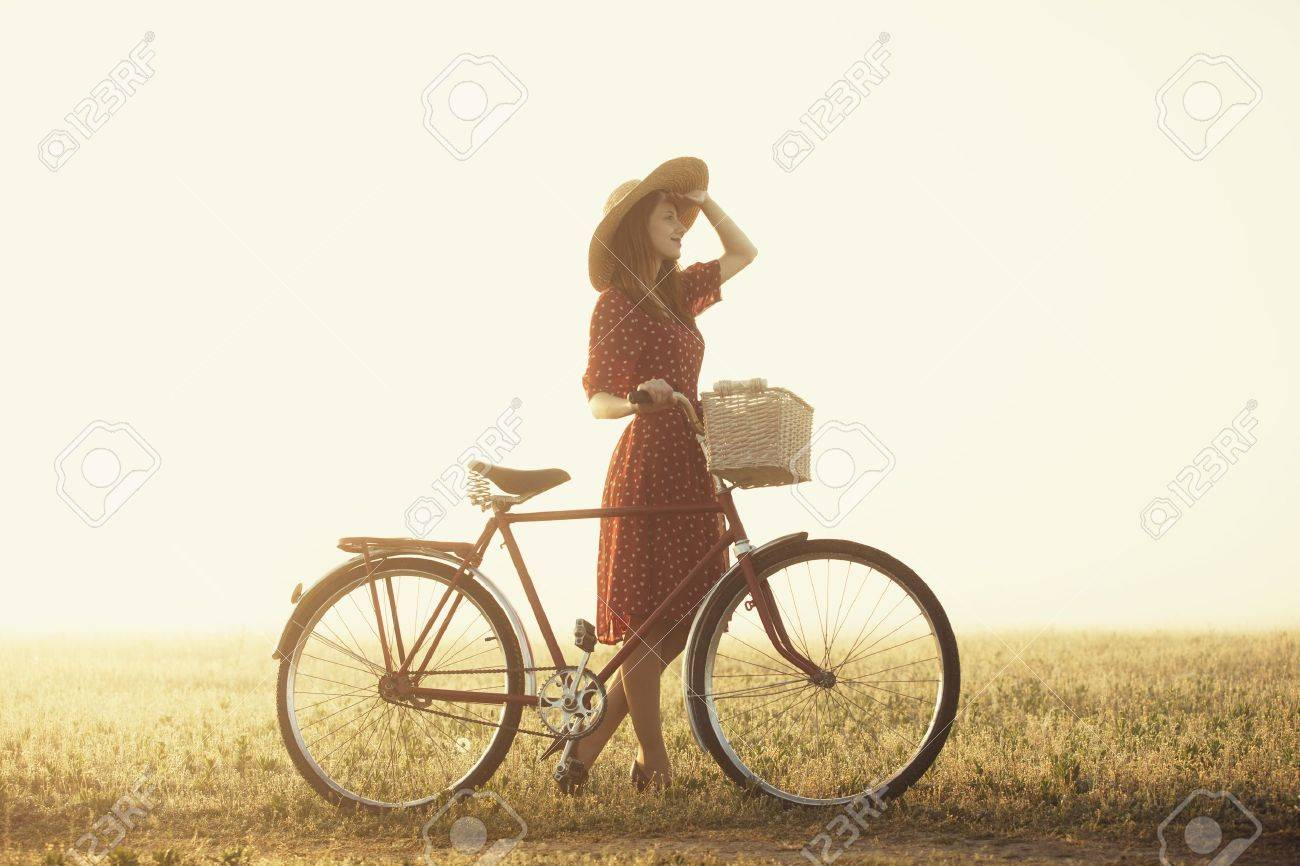 Girl on a bike in the countryside in sunrise time. Stock Photo - 19430887