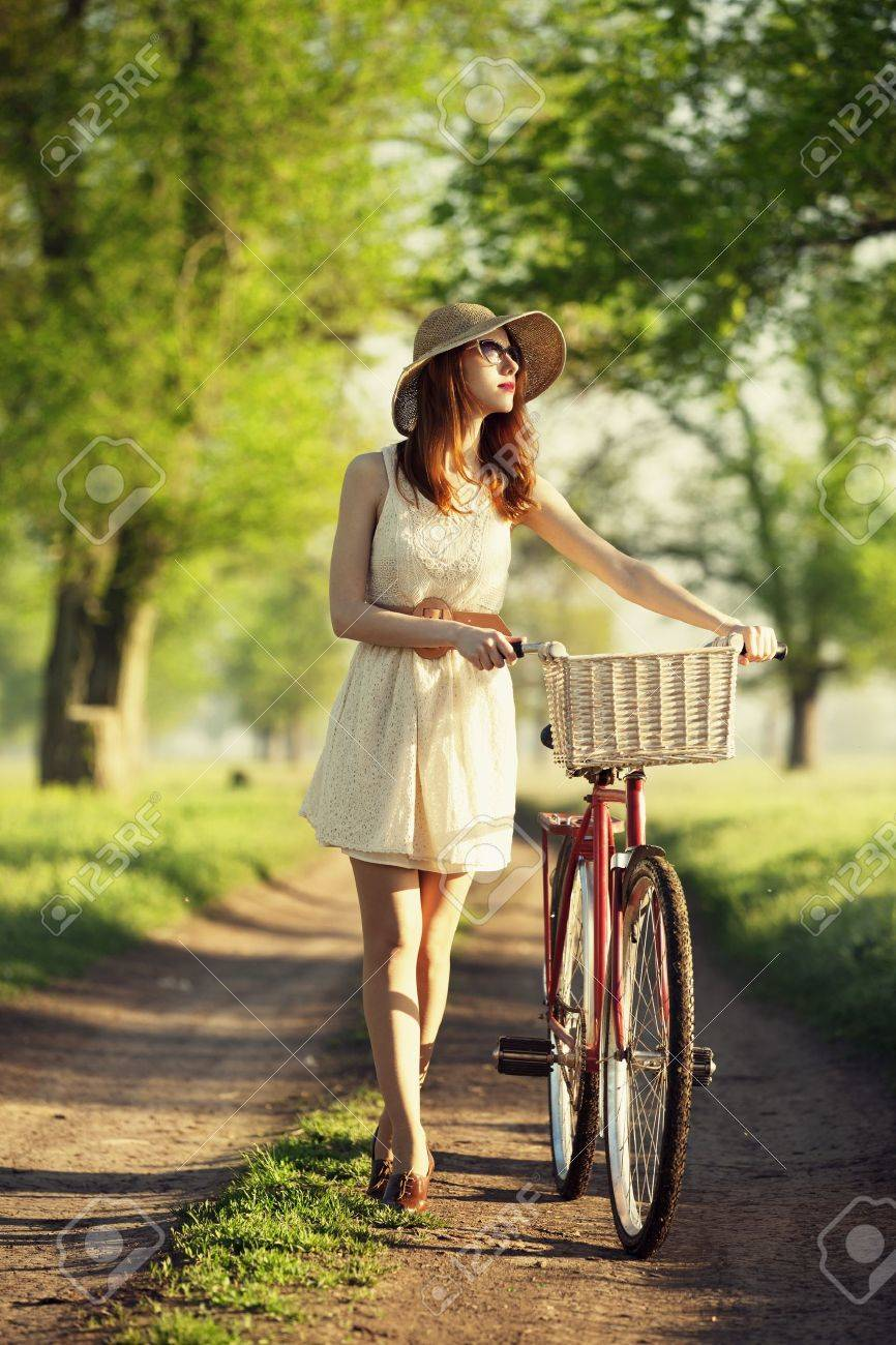 Girl on a bike in the countryside. Stock Photo - 19502168