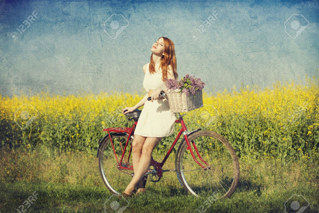 Girl on a bike in the countryside. Stock Photo - 19583692